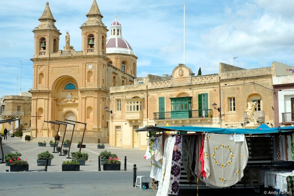 Marsaxlokk Parish Church, with a market stall in the foreground