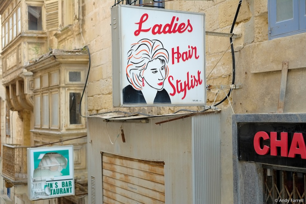 sign for a ladies' hair stylist