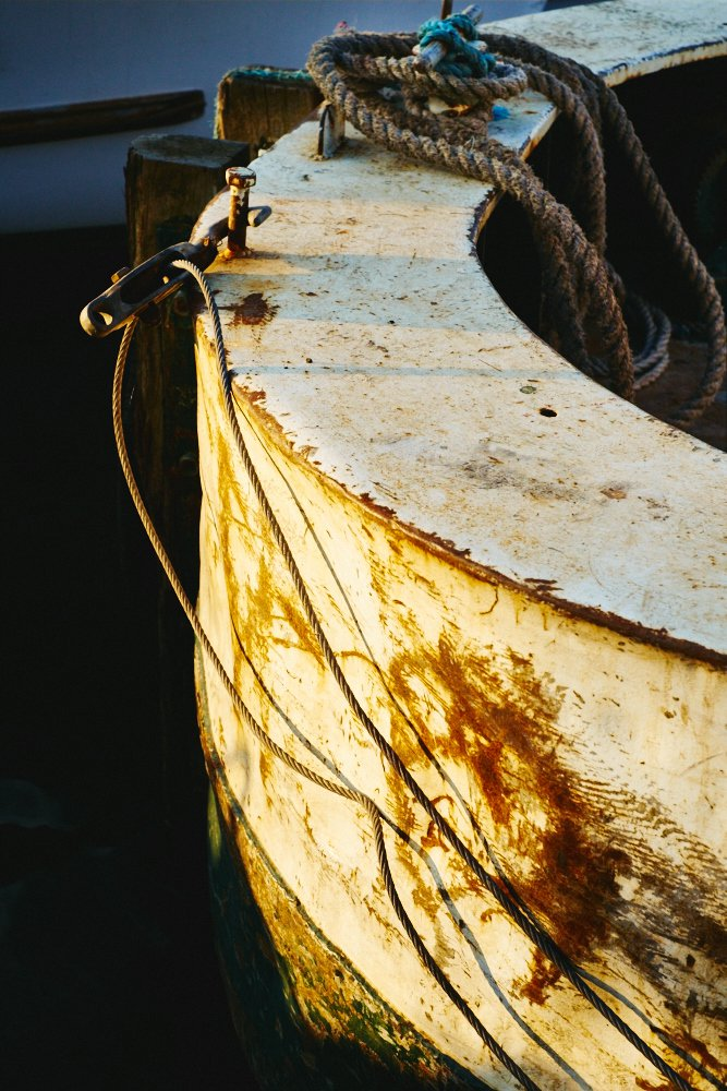 evening sunlit bow of a boat