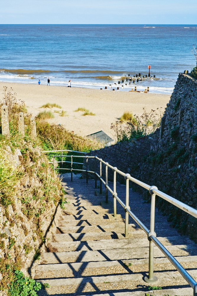 steps descending to the beach and sea