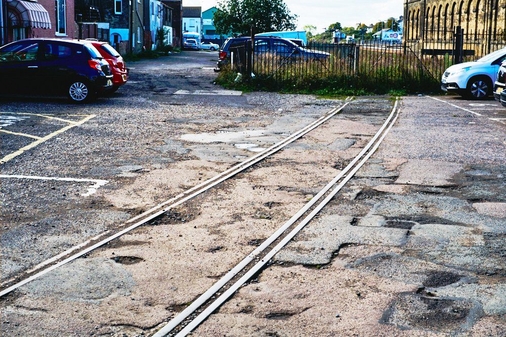 tram tracks to fence