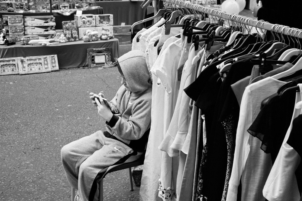 market boy on his phone