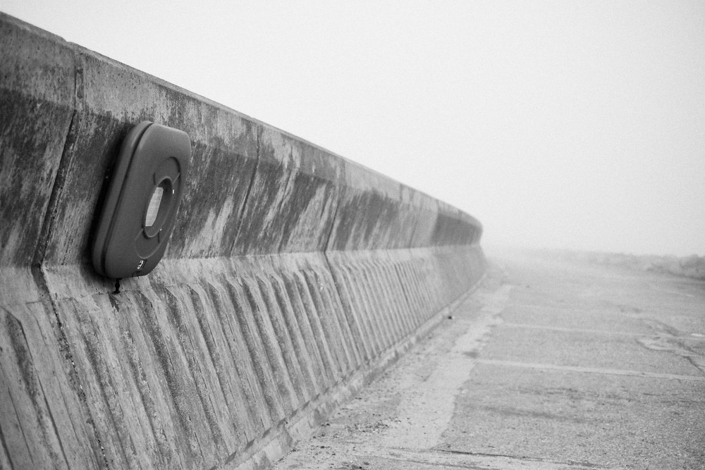 life ring on sea wall