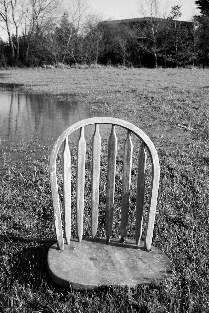 chair in a flooded field