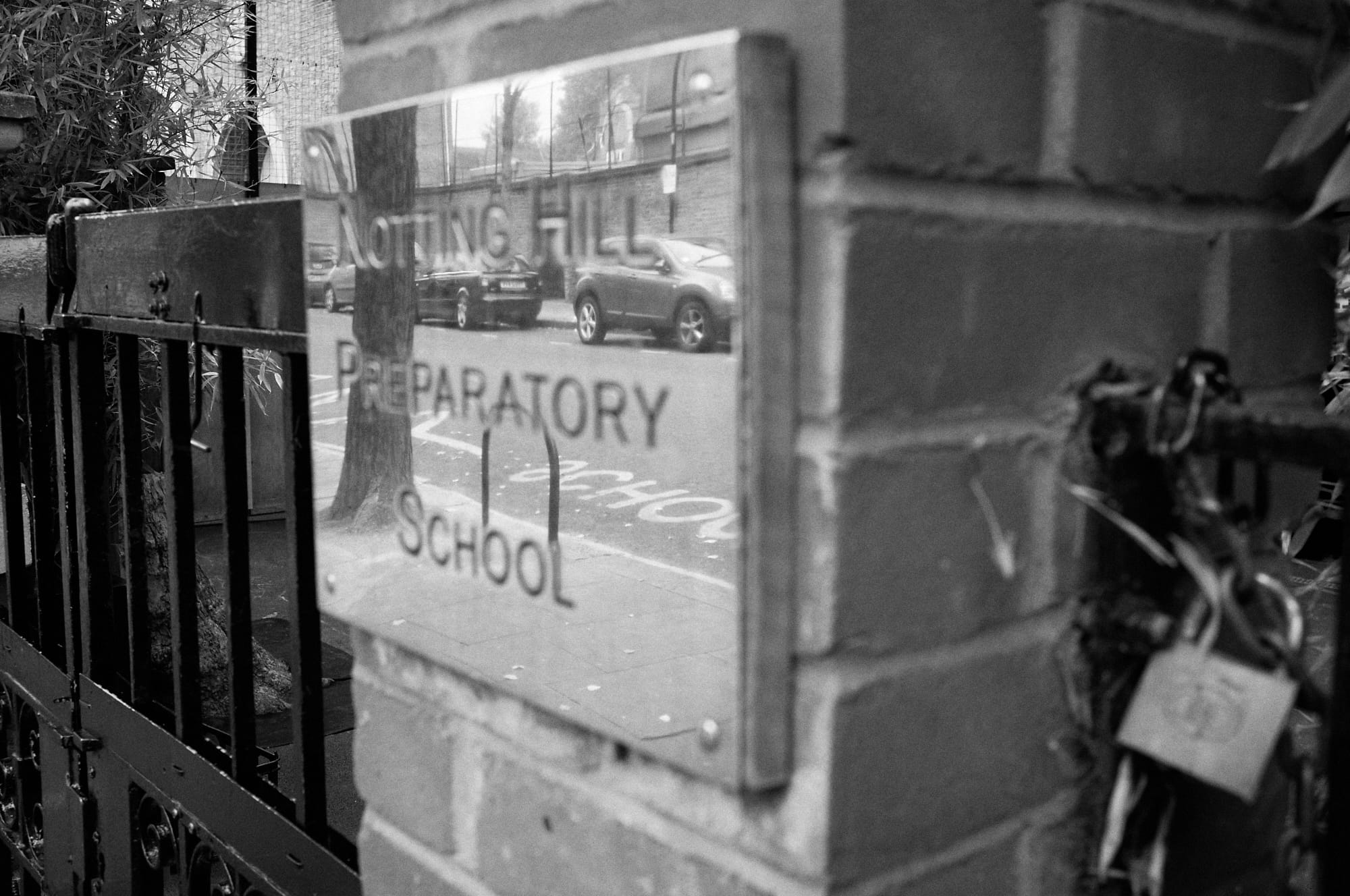 reflection in gate sign for Notting Hill Preparatory School