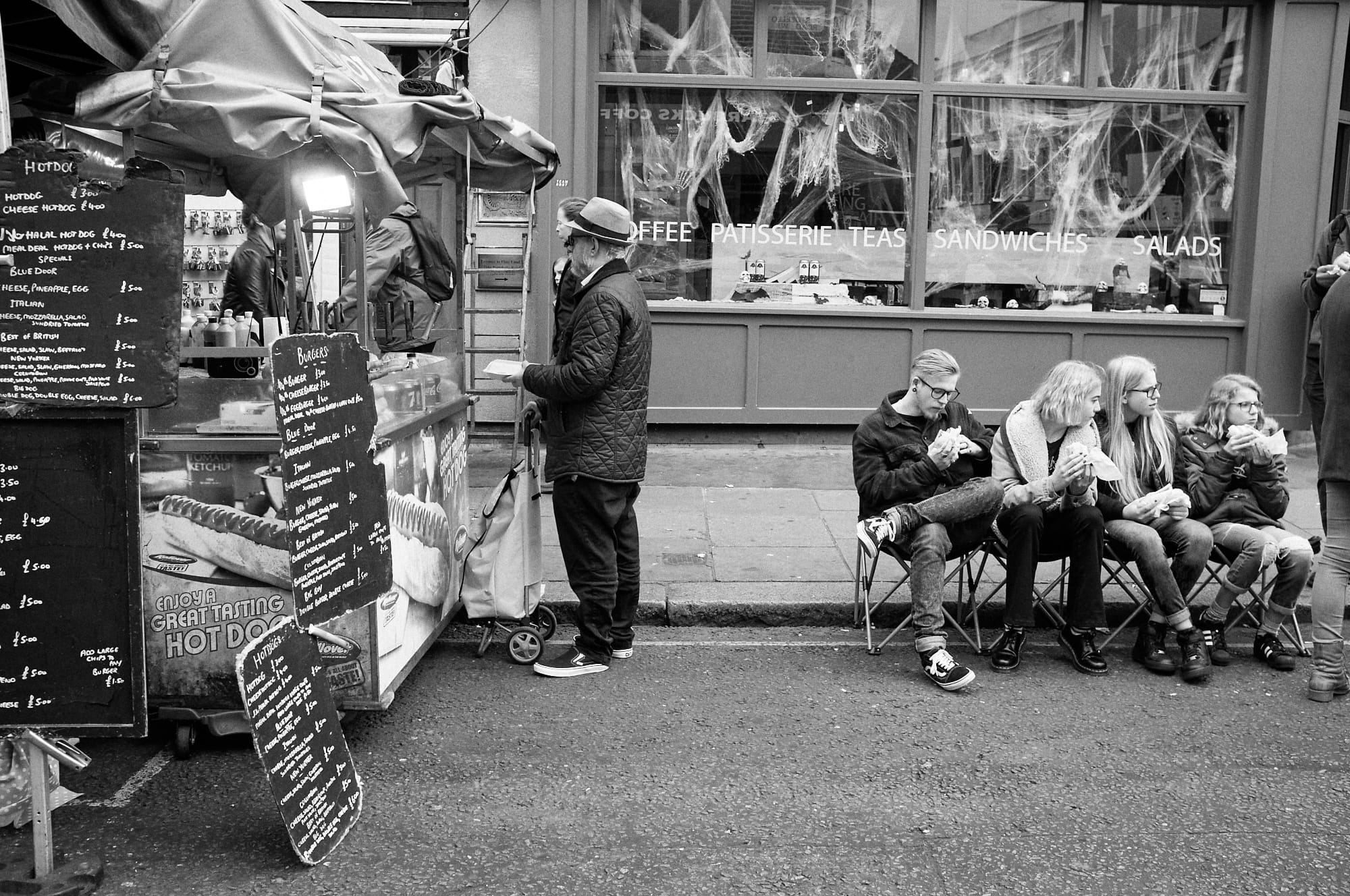 people seated eating street food