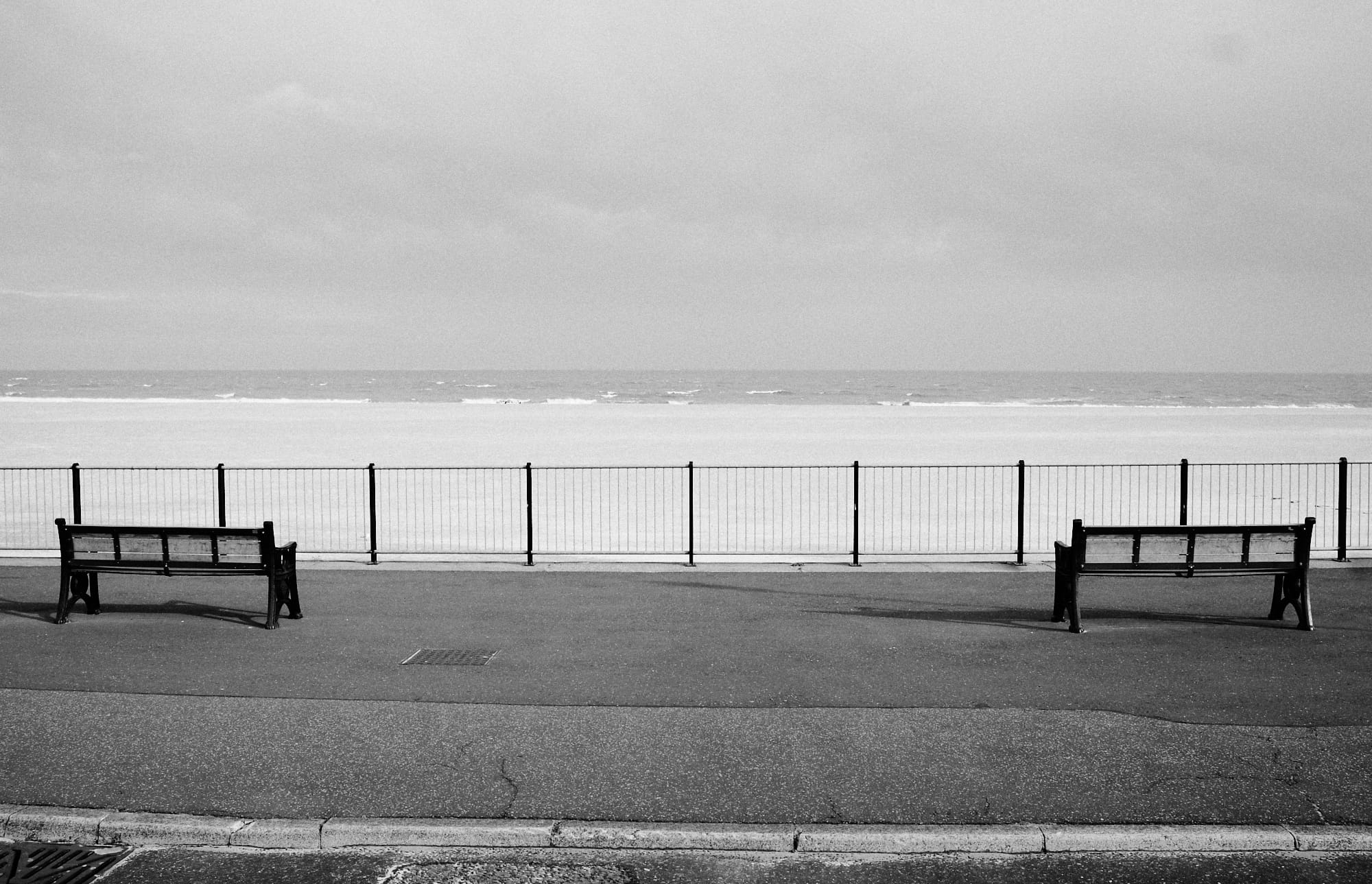 lower level promenade benches facing out to sea