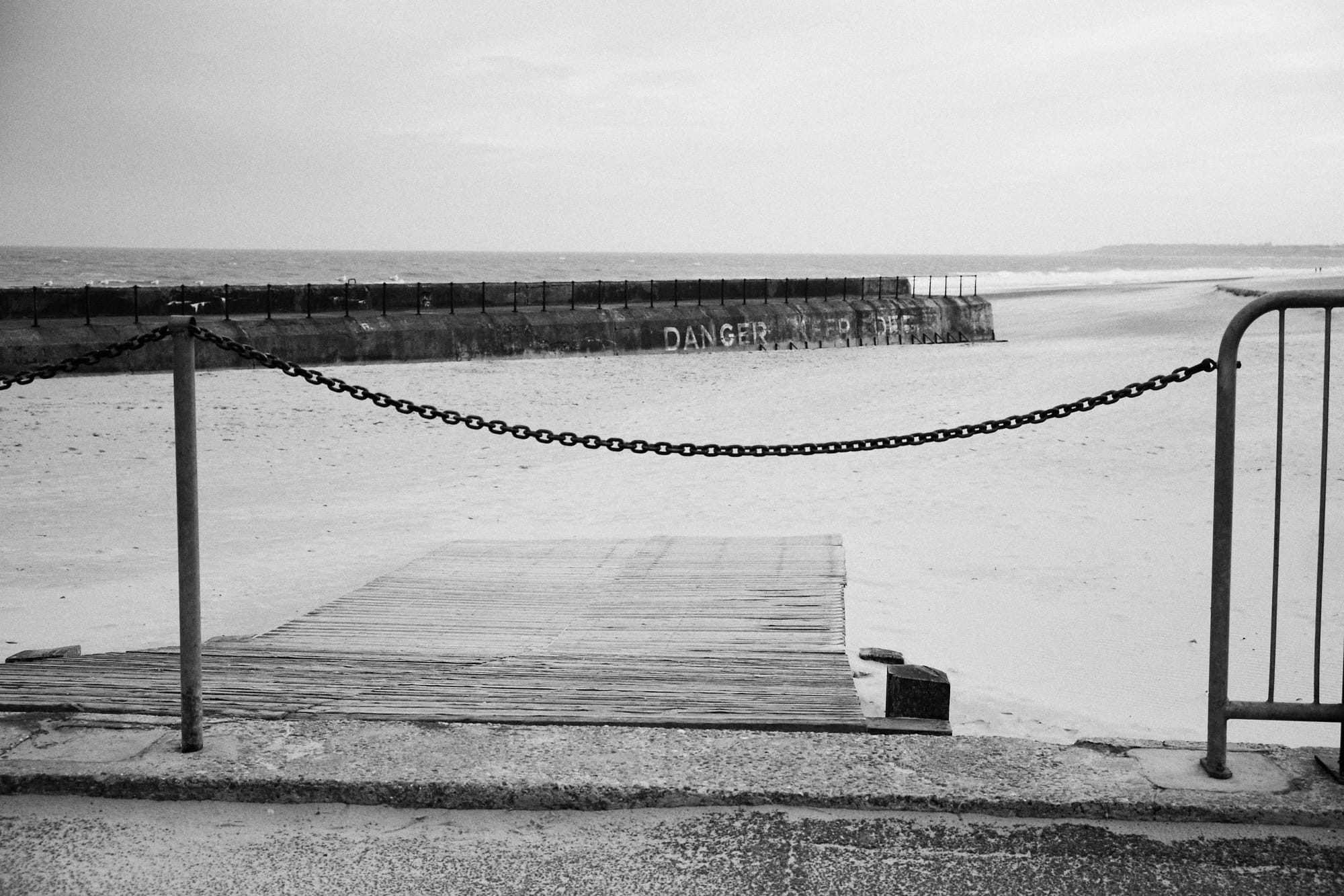 chain across ramp to the beach