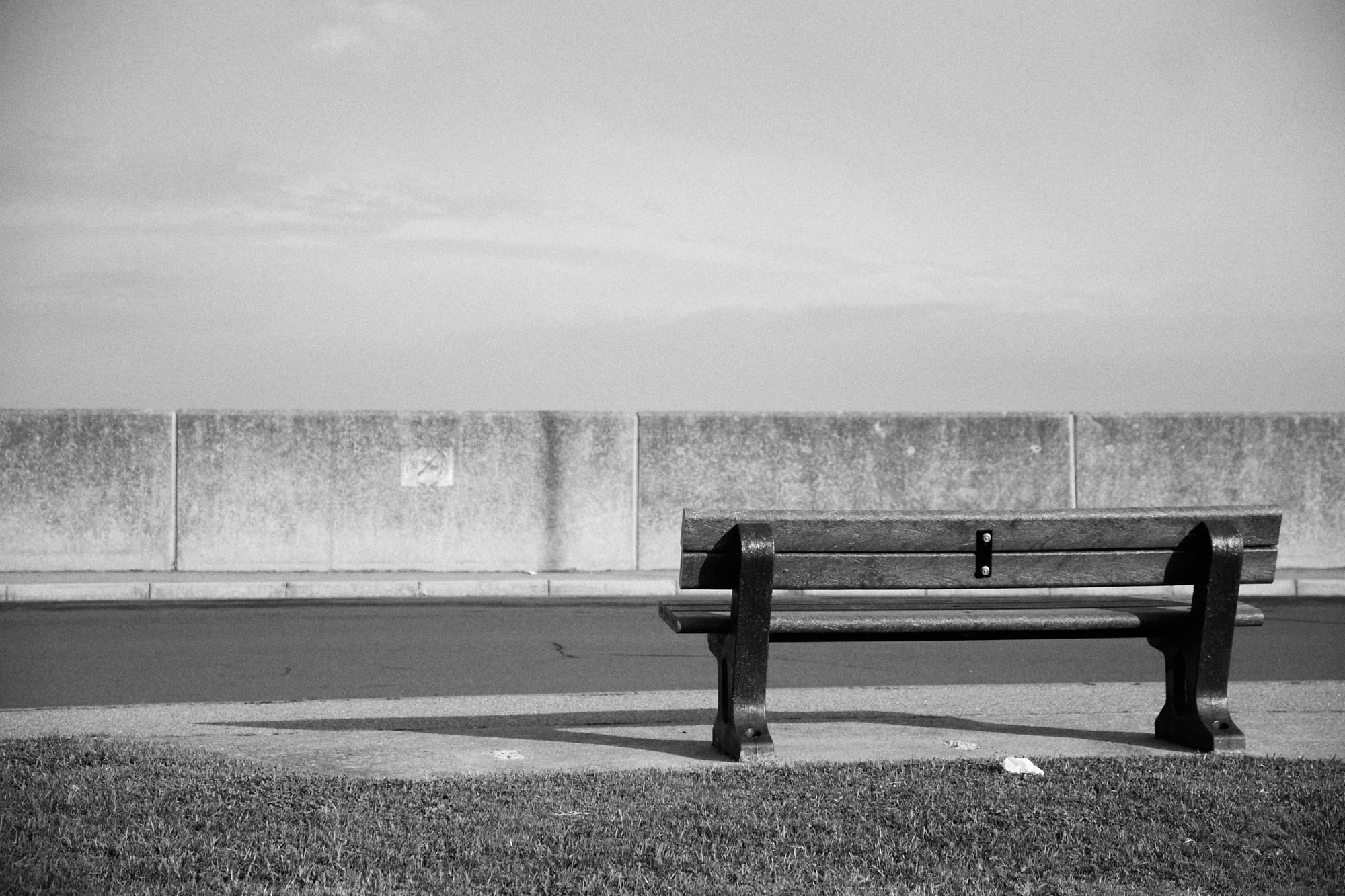 bench facing a sea wall