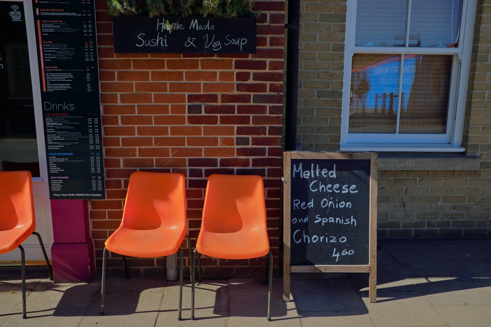 orange chairs outside cafe