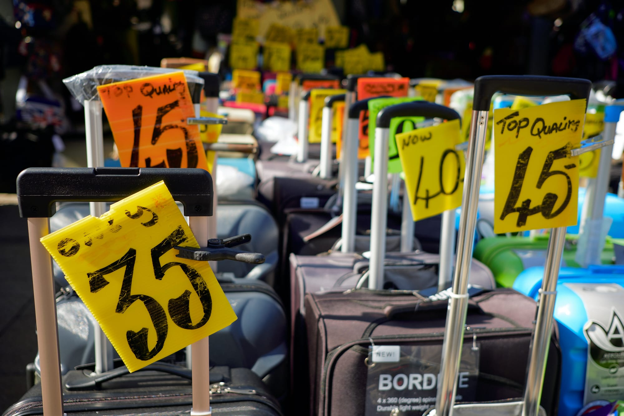 luggage price signs at market