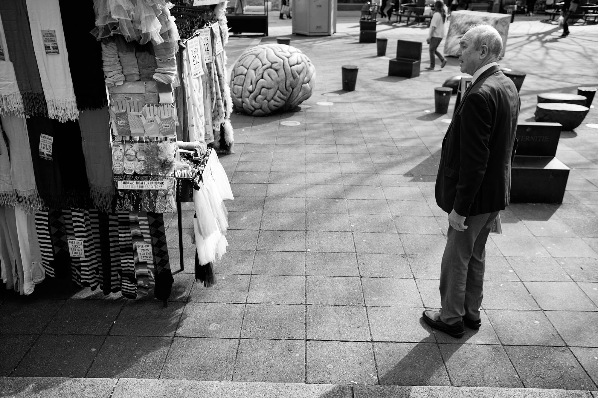 old man looking at market stall