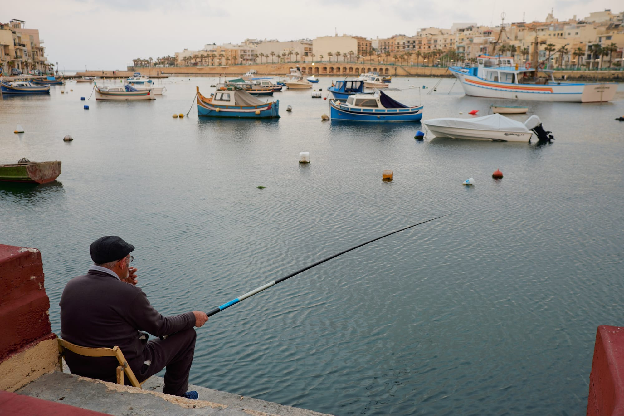 man fishing in Marsaskala bay