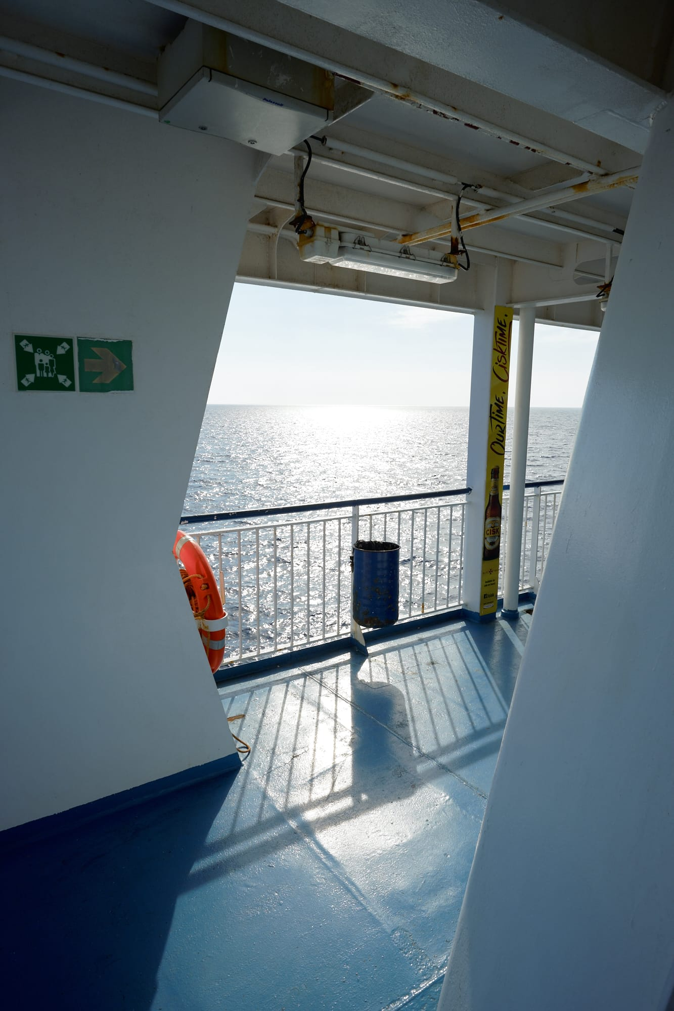 looking out over the side of the ferry towards the sun