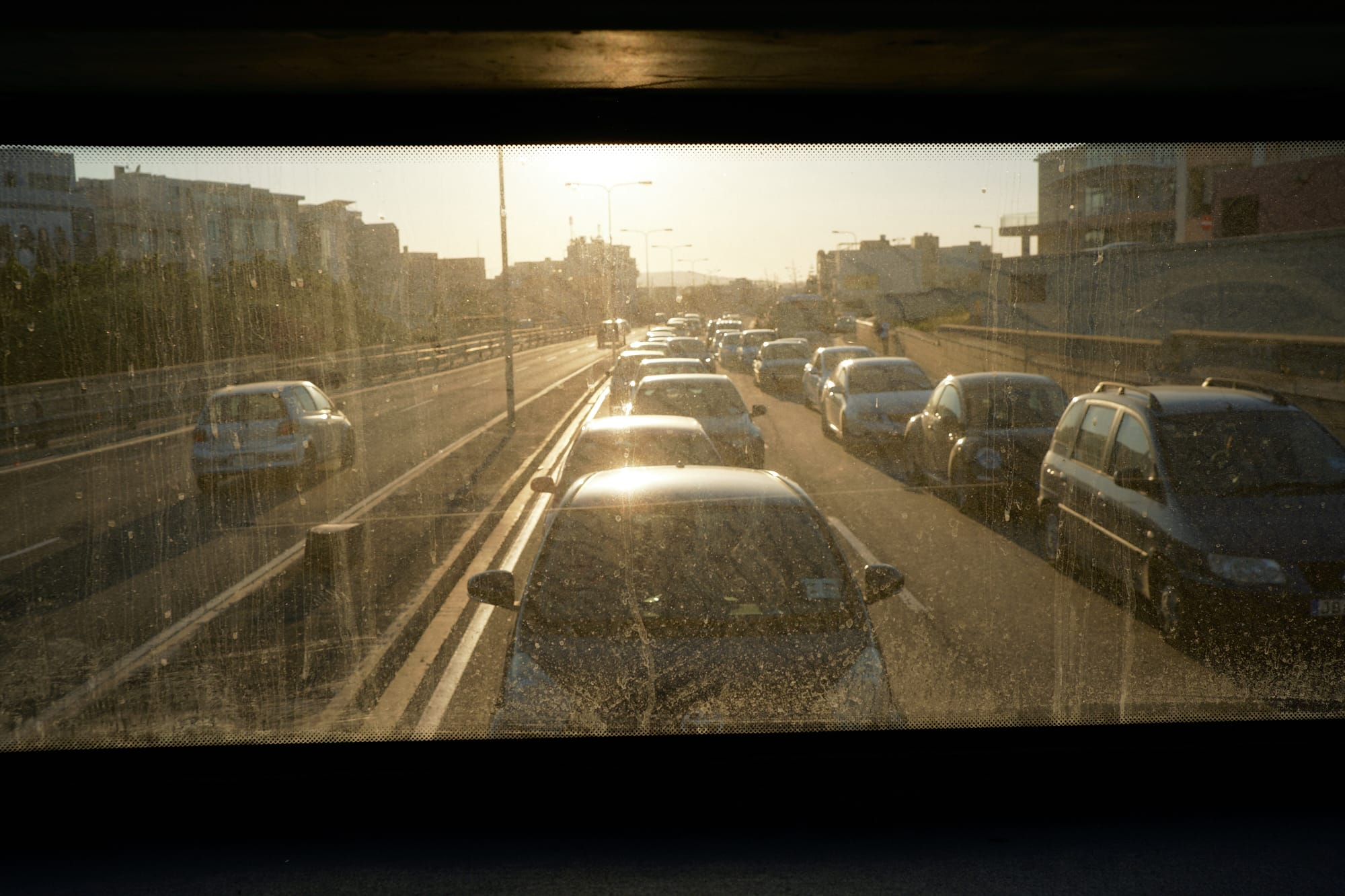 sun shining in the rear window of the bus from Ċirkewwa to Valletta