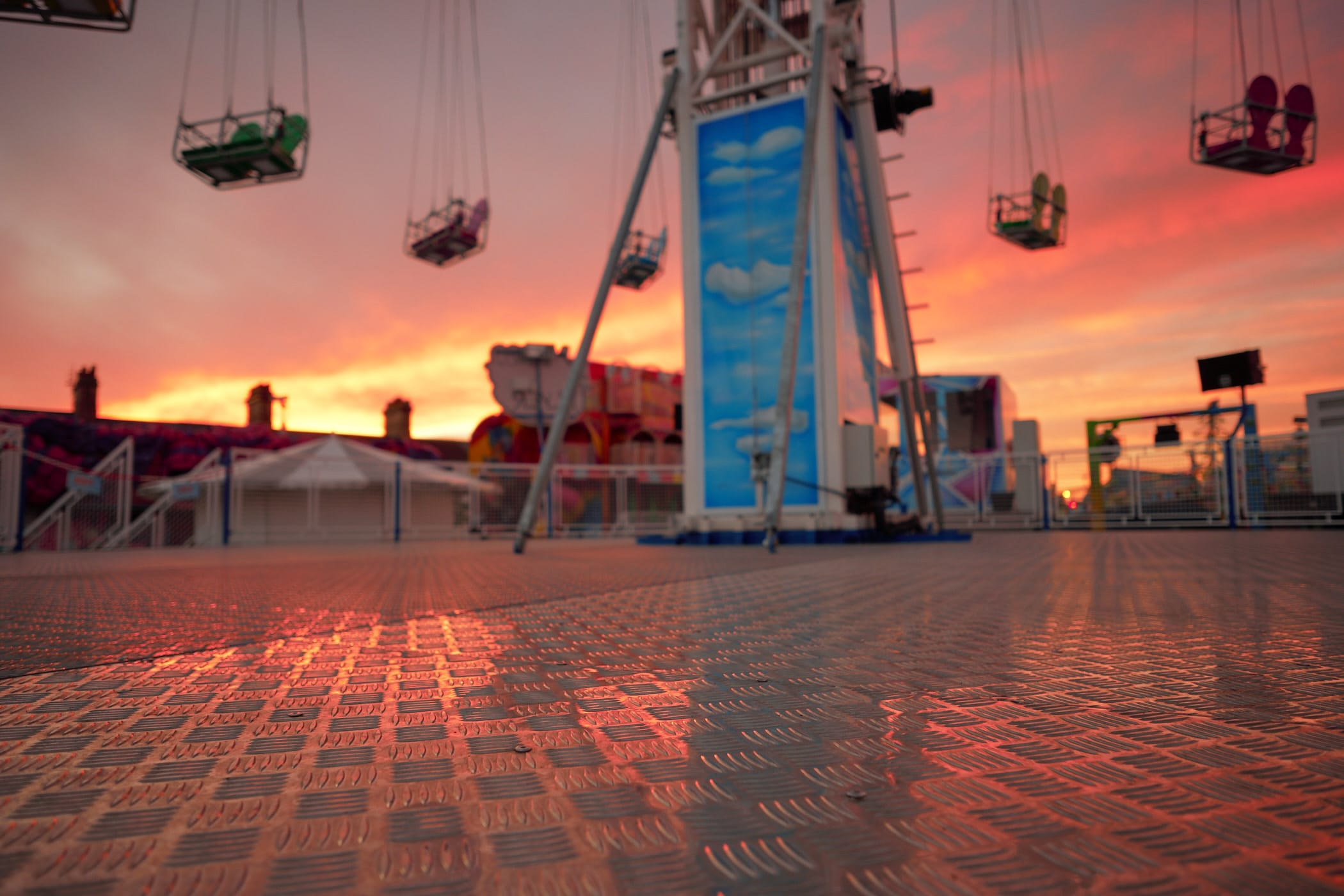 sunset sky reflected on ride floor