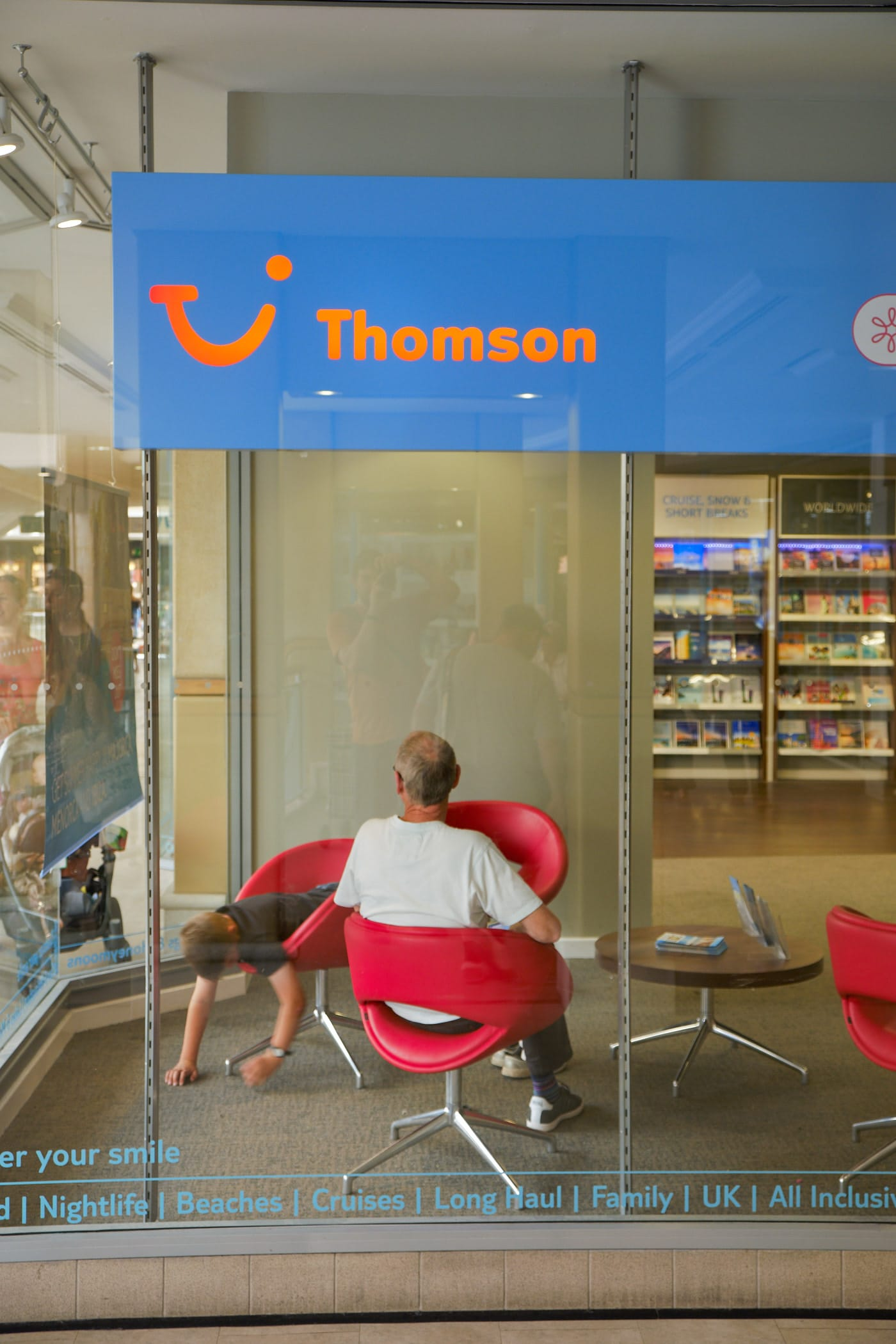 man and boy in Thomson travel agents