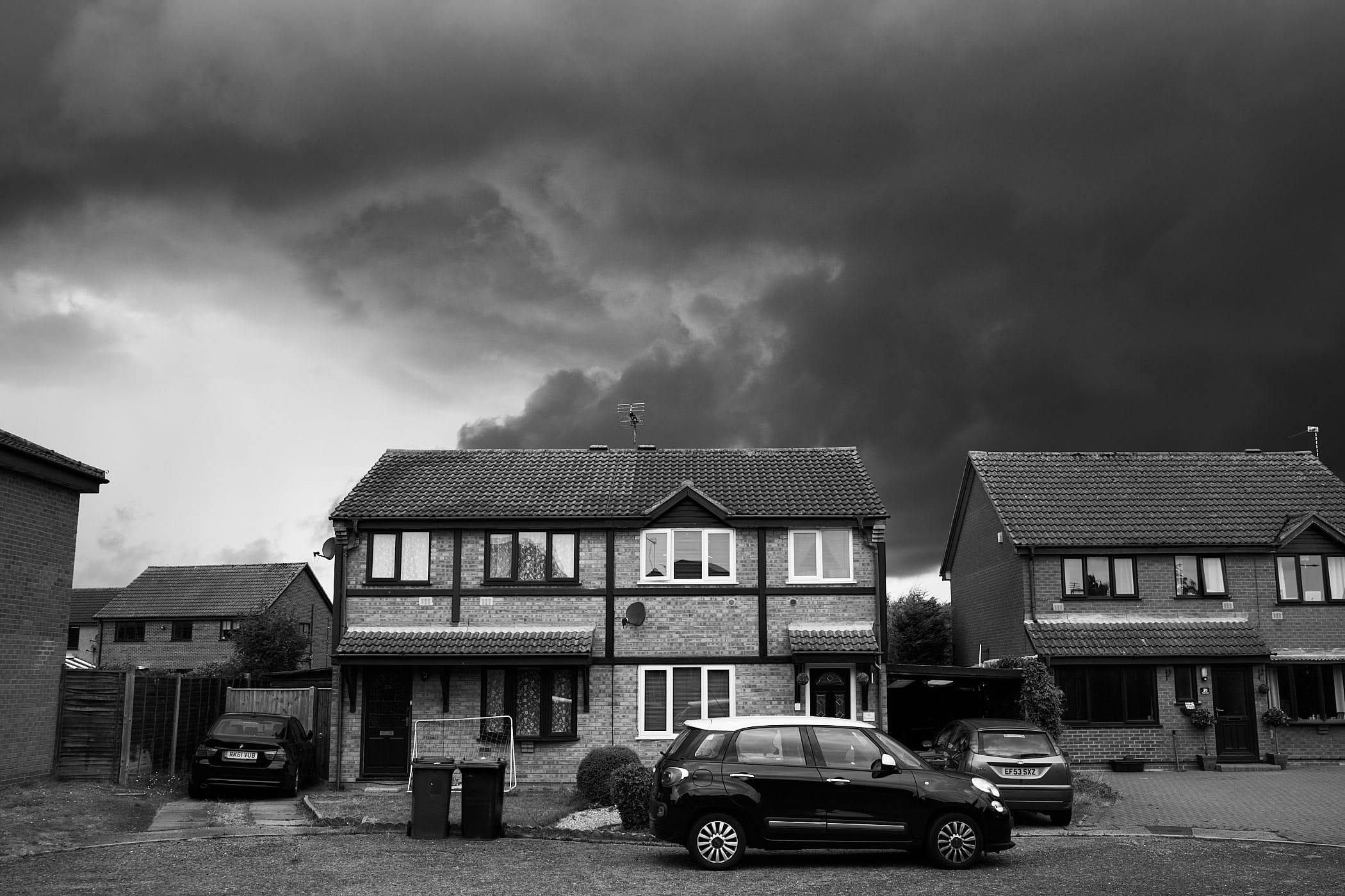brewing storm behind houses