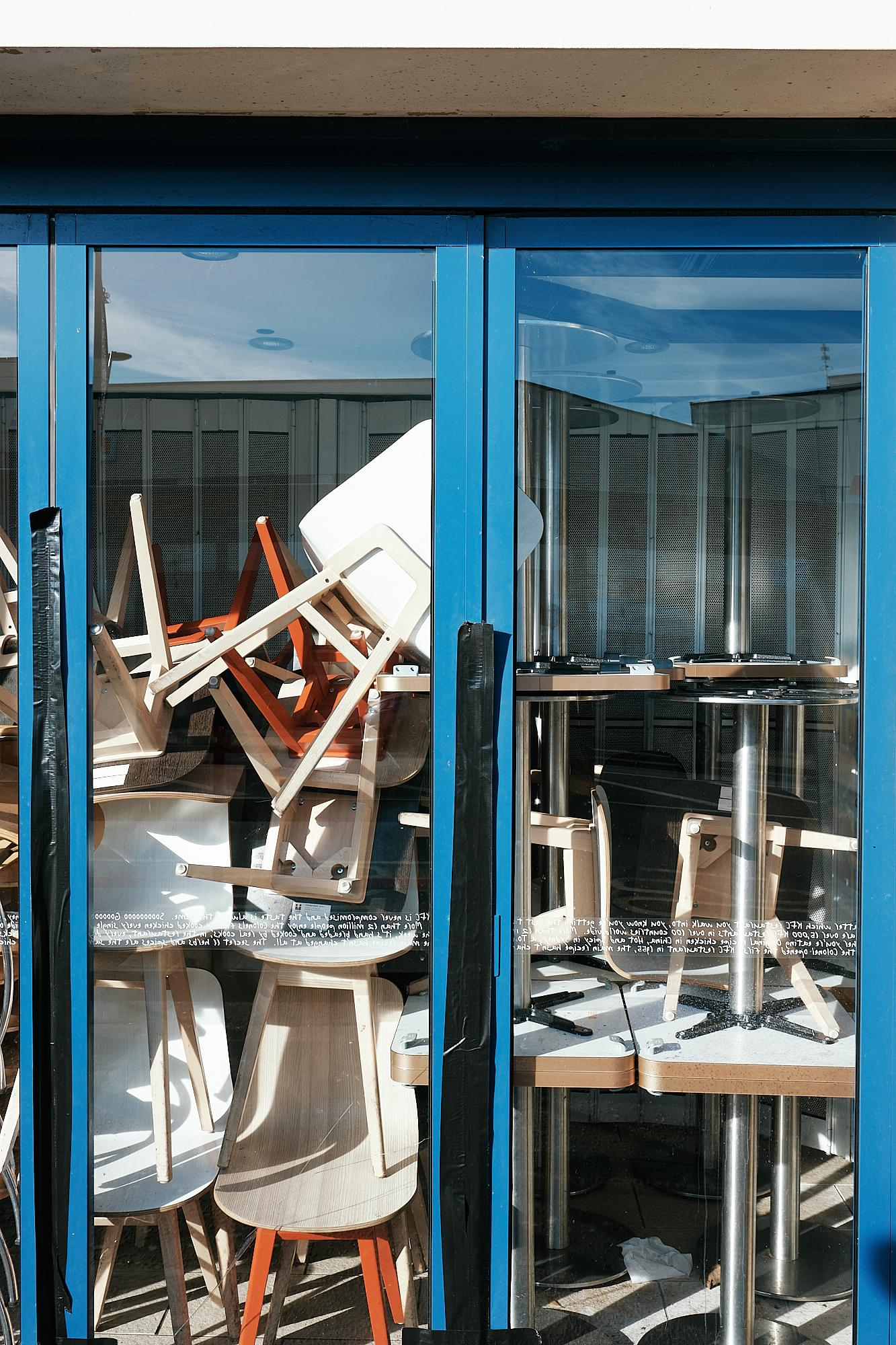 chairs stacked against shop window