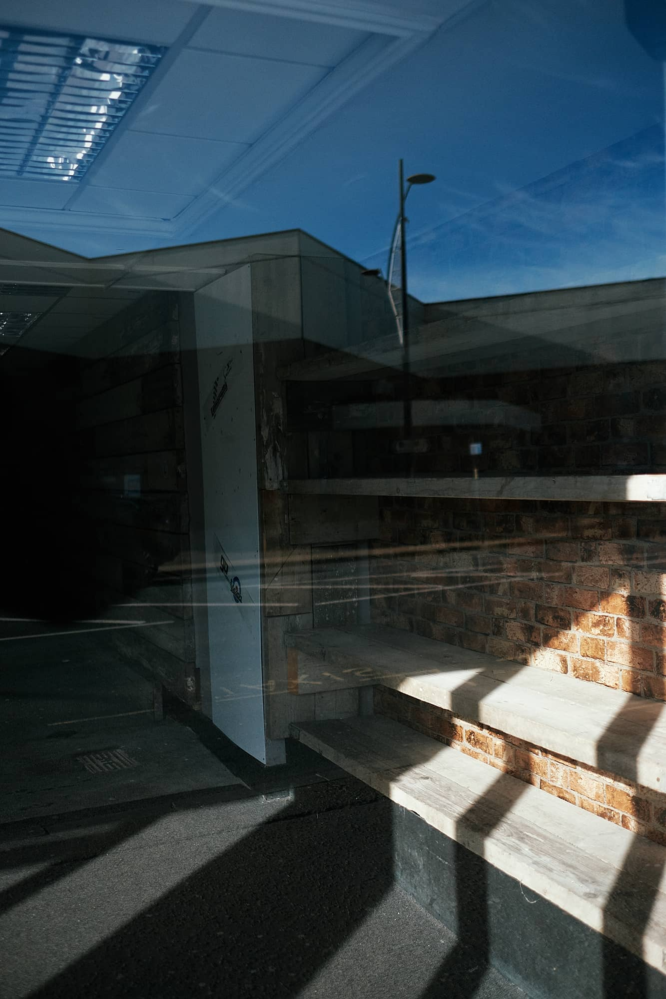 reflections and shadows in an empty shop building