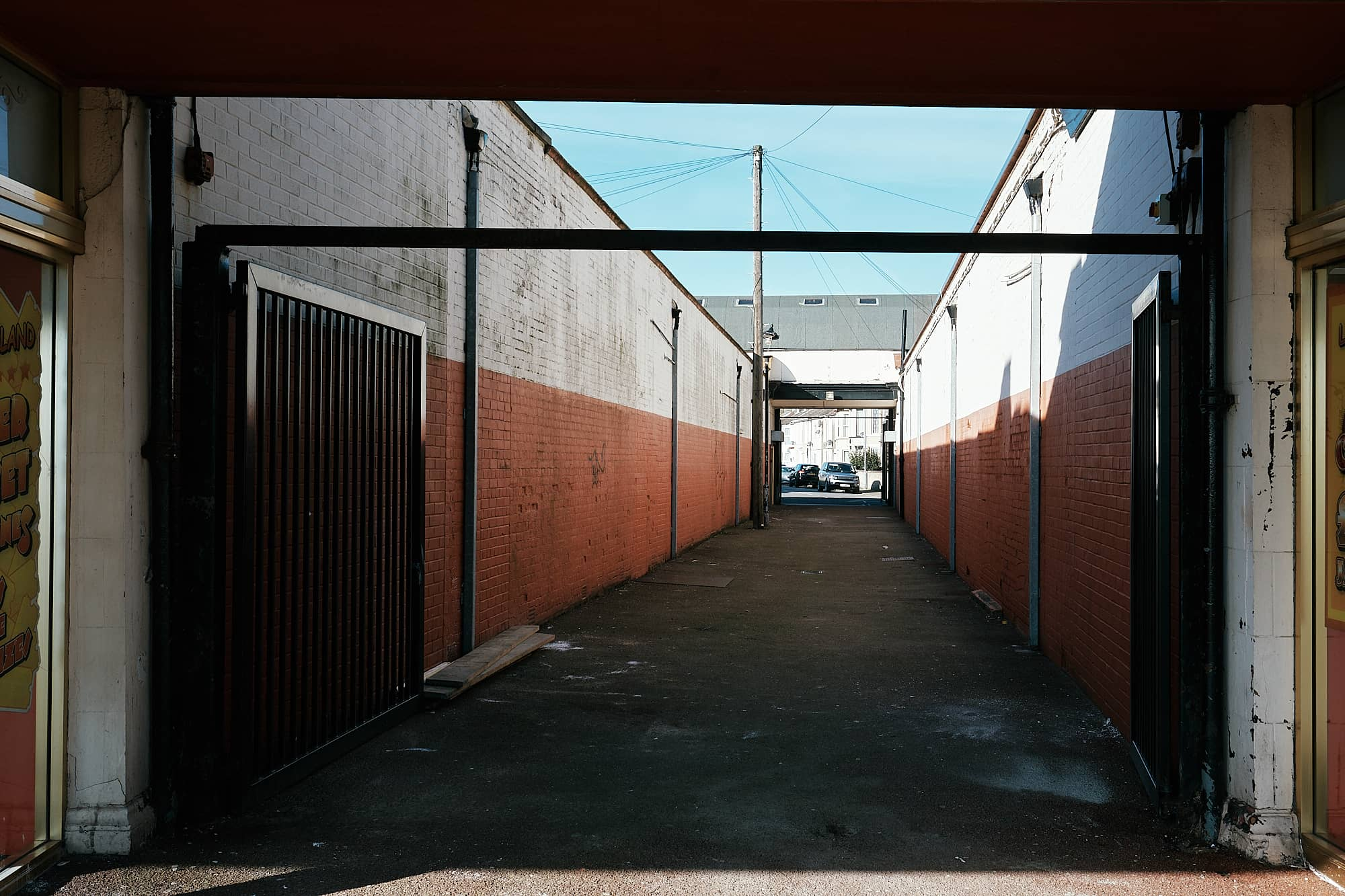 shaded alleyway with garages