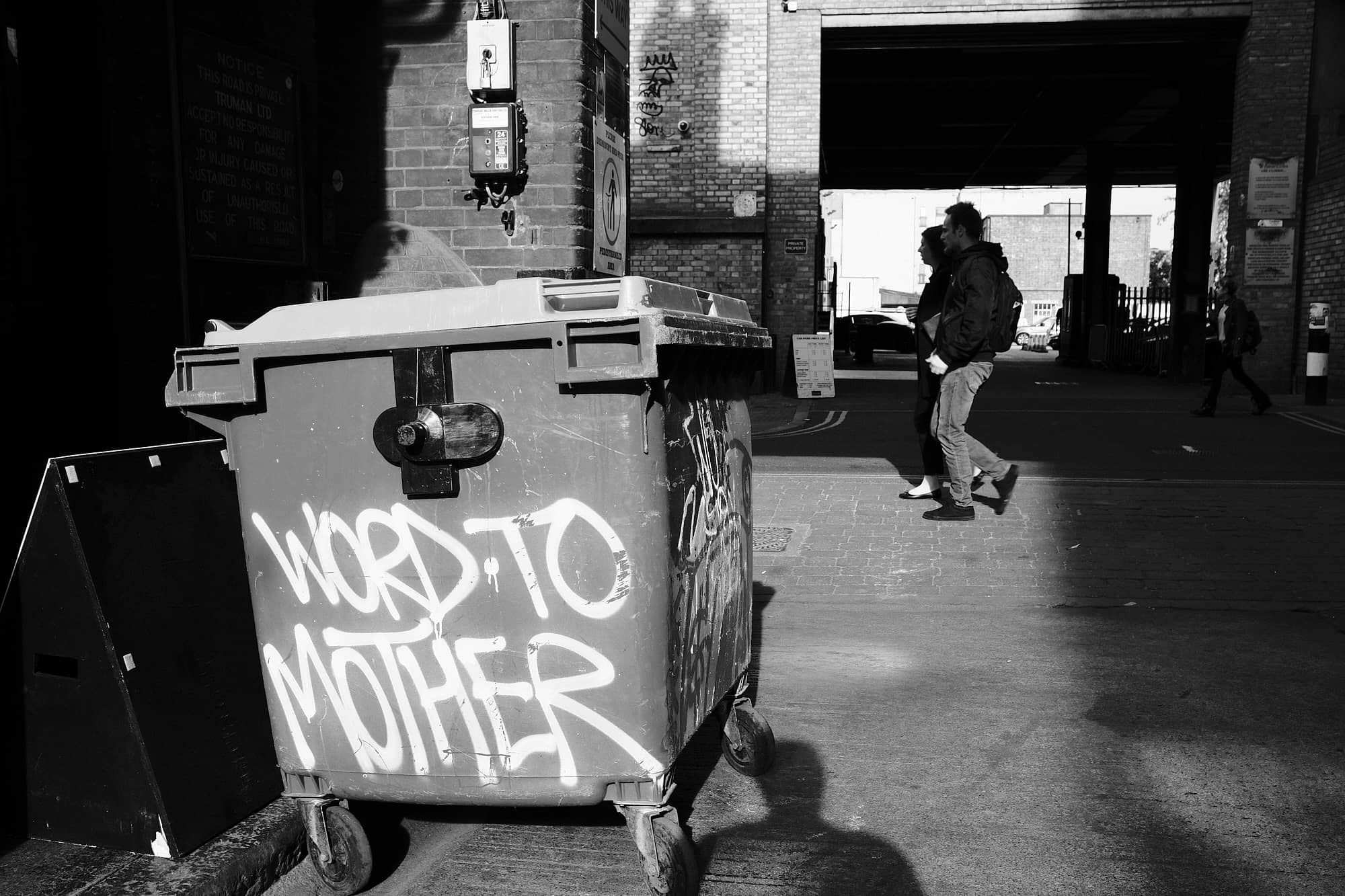 bin with 'Word To Mother' sprayed on it